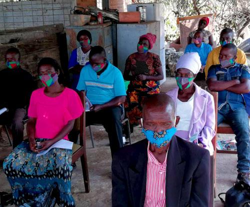 Committee members at a coronavirus awareness meeting in Malawi
