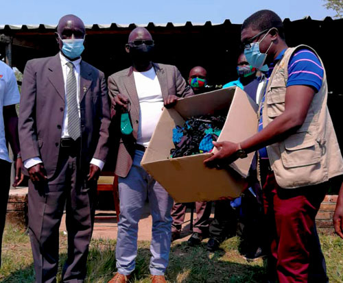 Distributing masks to Ripple Africa team and conservation committee members